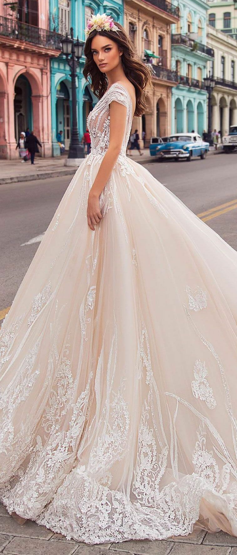 Off-the-shoulder v-neck, fitted bodice and gorgeous train that is embellished with floral lace will leave everyone speechless #wedding #weddingdress #weddinggown #bridedress