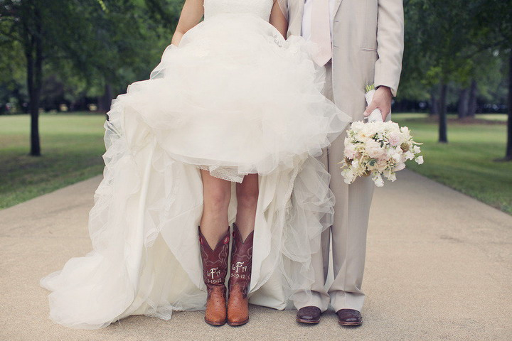 Bride worn cowboy boots under her gorgeous wedding dress | itakeyou.co.uk #wedding