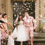 wedding confetti throw at bride and groom