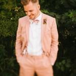 the groom in peach suit