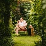 groom in peach coloured suit with bowtie, bride and groom wedding photo ideas,bride and groom retro garden wedding
