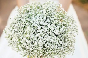 The bride bouquets was made entirely out of baby's breath, accented with a cheery yellow-and-white striped ribbon