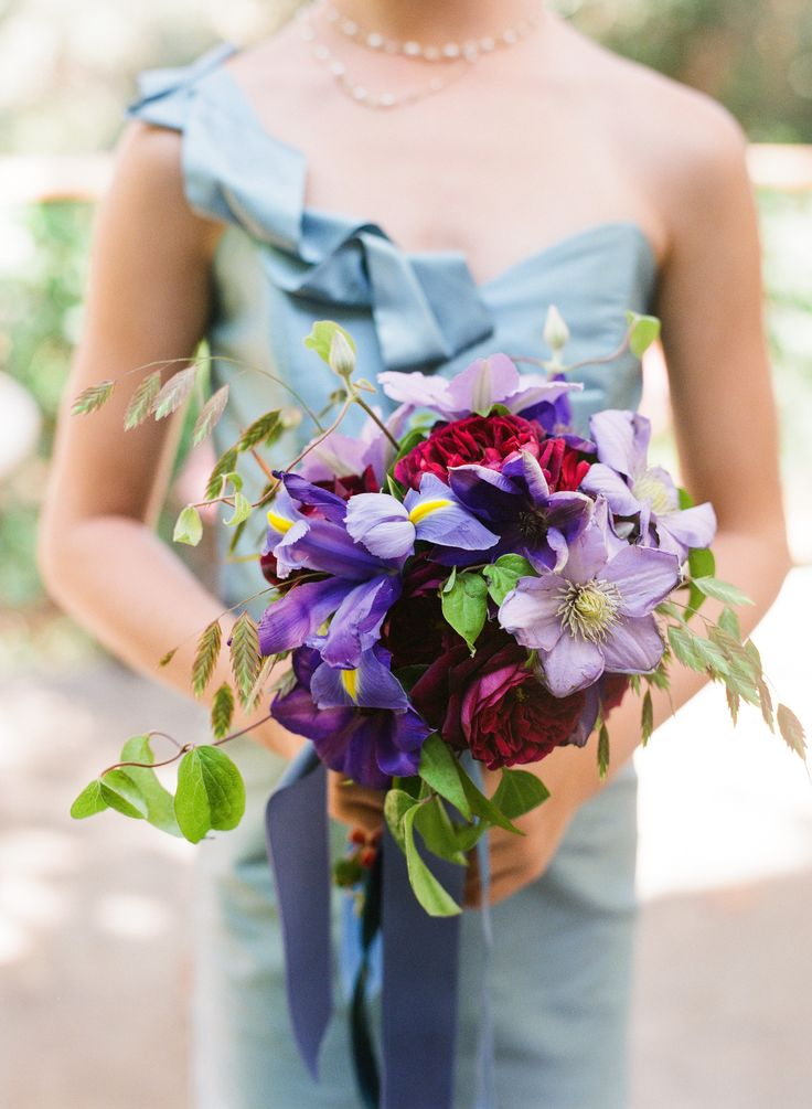 creative wedding bouquet with blue and purple flowers