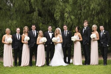 Bride in Steven Khalil wedding dress and neutral bridesmaids