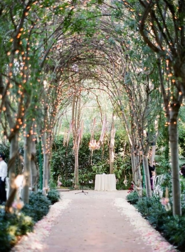 Unconventional wedding ideas | garden wedding ceremony twinkle lights and a floral chandelier #weddingceremony #gardenwedding