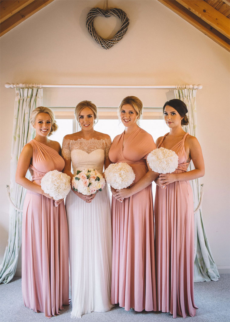 Blush pink mismatched bridesmaid dresses + ivory wedding bouquets #wedding #bouquets