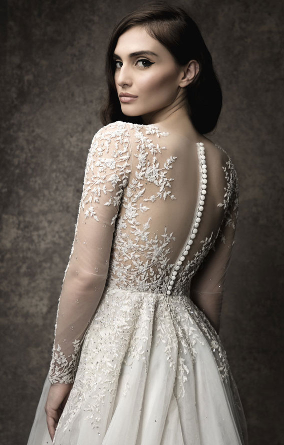 A-line gown with off the shoulder illusion neckline and long sleeves, natural waist. Enaura 2019 Wedding Dresses