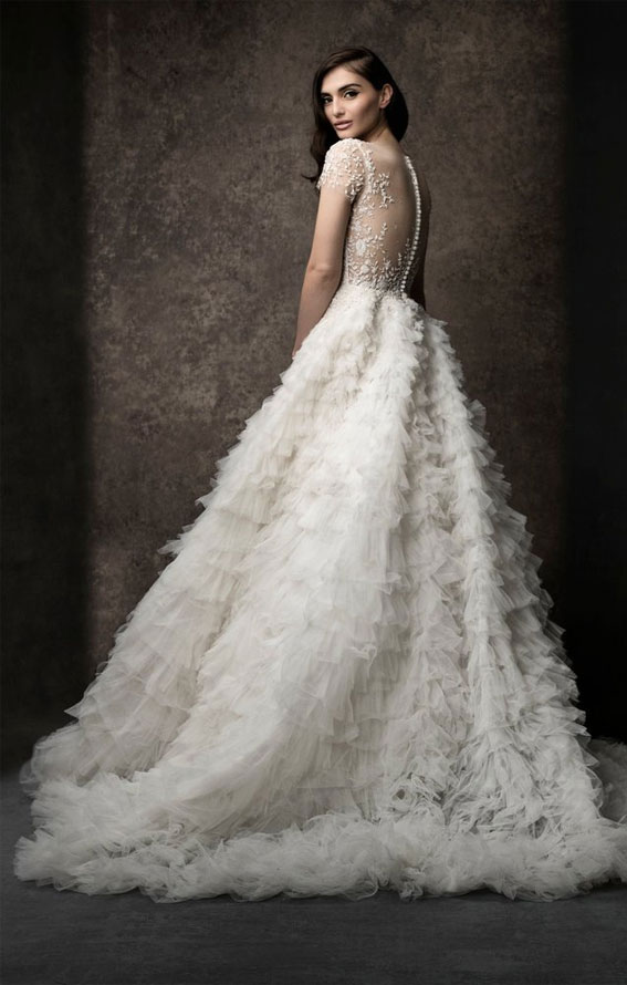 OPHELIA :A-line gown, short sleeve illusion neckline, with scooped lining. Natural waist fully ruffled skirt with beading and scattered beading on skirt.Enaura 2019 Wedding Dresses #weddingdress #wedding wedding gown