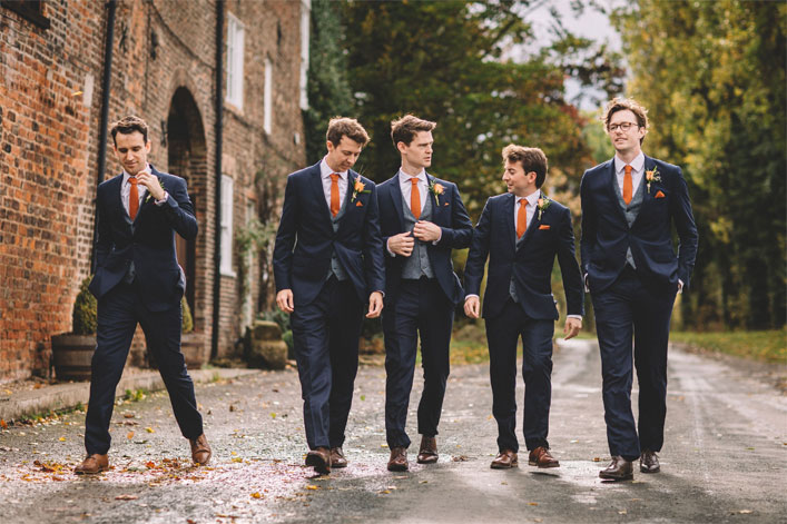 Warm Autumn wedding - Groom and groomsmen in dark blue suit with orange ties