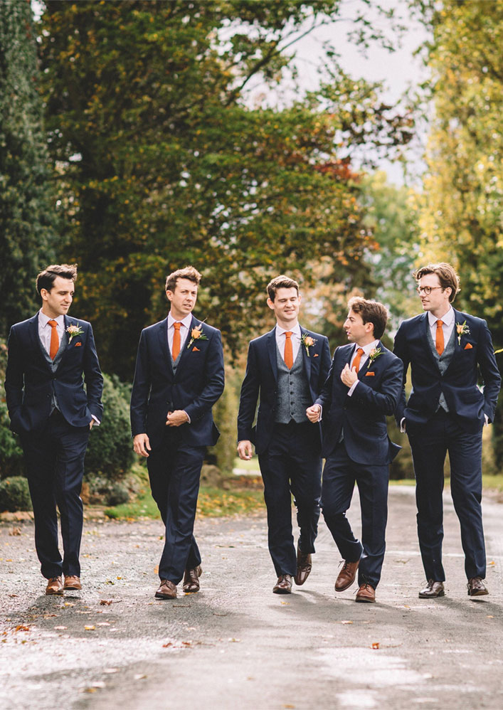 Autumn wedding - Groom and groomsmen in dark blue suit with orange ties