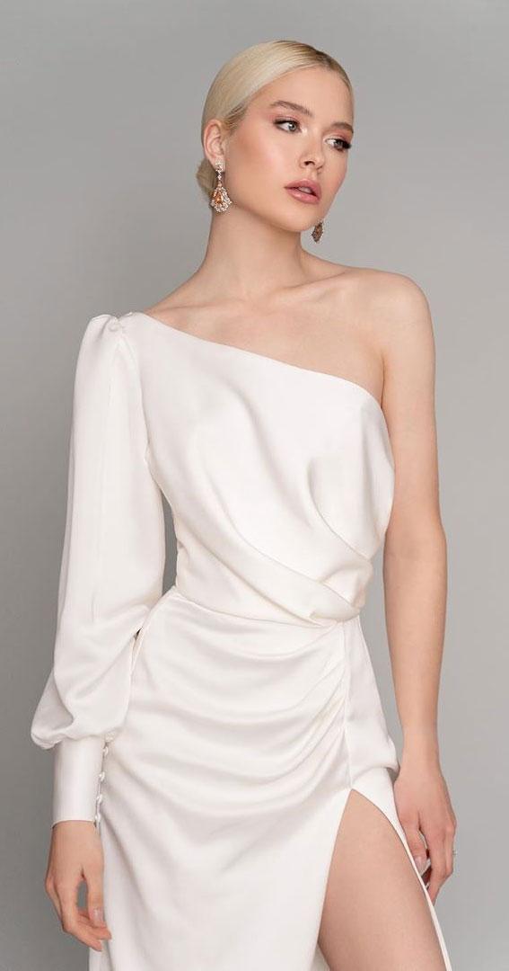 one shoulder long sleeve wedding dress with side split, sheath wedding dress with sleeves #wedding #weddingdress one shoulder minimalist wedding dress, modern wedding dress